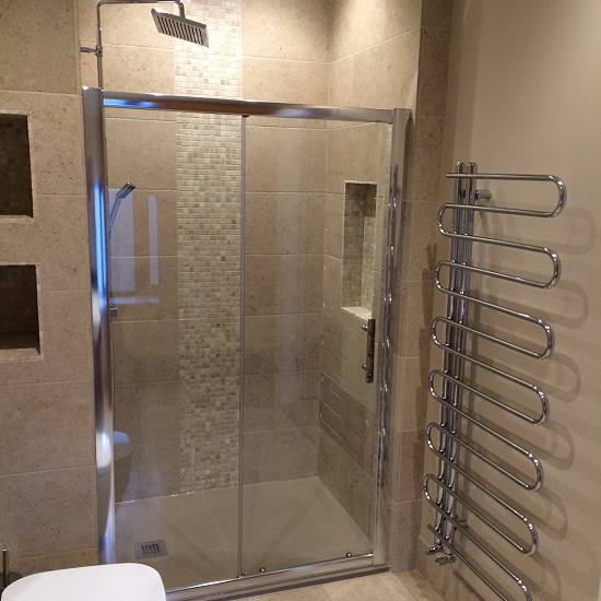 Ensuite shower room with limestone tiles