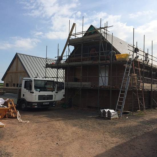 Plot 1 sandstone facing and slate roof near completion